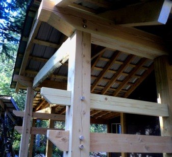 Pegged mortise and tenon joinery for a deck roof. Mortise and tenons are strong and beautiful and give a hand-crafted feel to a timber strucure.