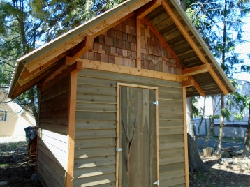 A tool shed showing that small buildings can be well-designed and built, and add a lot of pleasure to a garden.