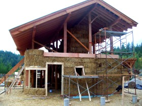 Douglas Fir timber frame with straw-bale wrap going up